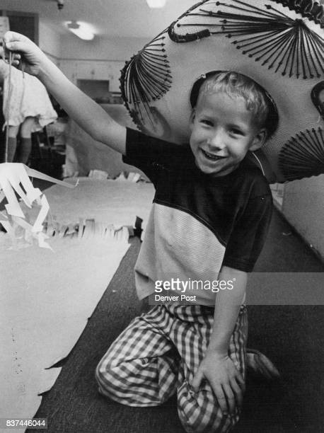 First Grader Danny Farrell Hawks Paper Mobile at Mercado The mobiles were fashioned by students at Fairview Elementary School Credit The Denver Post