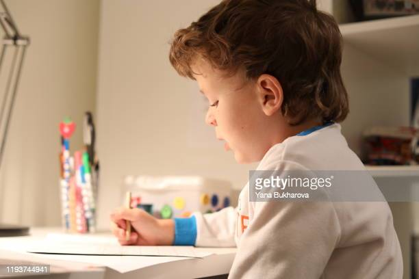 first grader doing his homework - first occurrence stock pictures, royalty-free photos & images