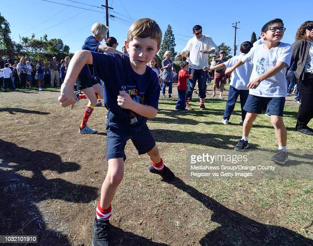 First grader Jack Piazza cuts a rug as he joins his classmates as they break a world record for largest freeze dance at St Joseph Catholic School in...
