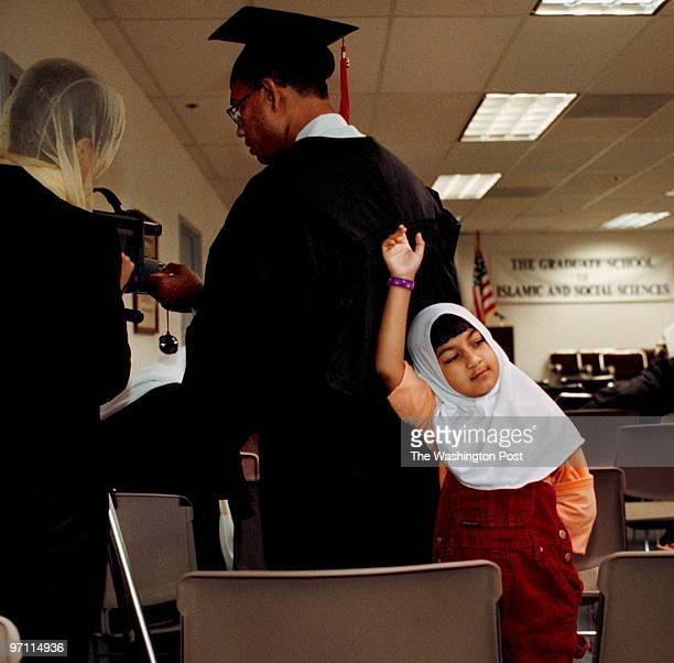First graduation at Graduate School of Islamic and Social Sciences in Leesburg VA Wearing cap and gown Mohammed Mokarram Hossain sets up a video...