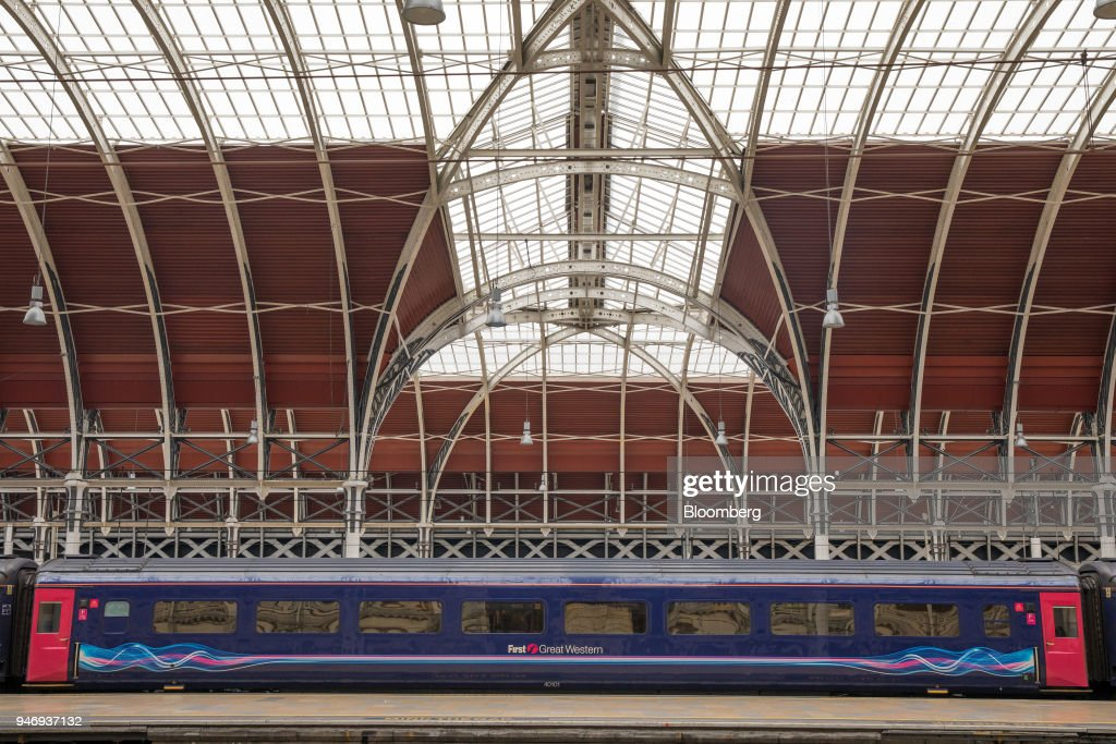 A First Great Western train, operated by FirstGroup Plc, sits stationary at London Paddington railway station in London, U.K., on Monday, April 16, 2018. British train and bus operator FirstGroup Plc said it rejected an 'opportunistic' takeover proposal that private-equity firm Apollo Management made as the company struggles with under-performing rail routes in the U.K. and competition from discount airlines in the U.S. Photographer: Jason Alden/Bloomberg via Getty Images