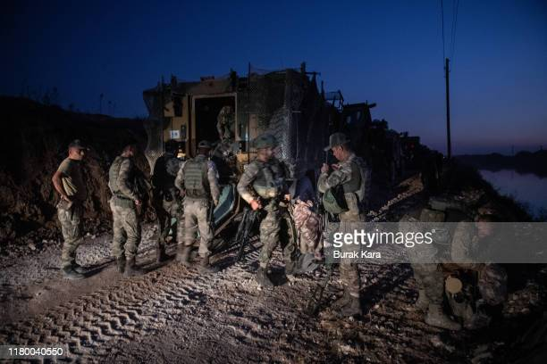 First group of Turkish infantry prepare to enter Syria on the border between Turkey and Syria on October 09, 2019 in Akcakale, Turkey. The military...