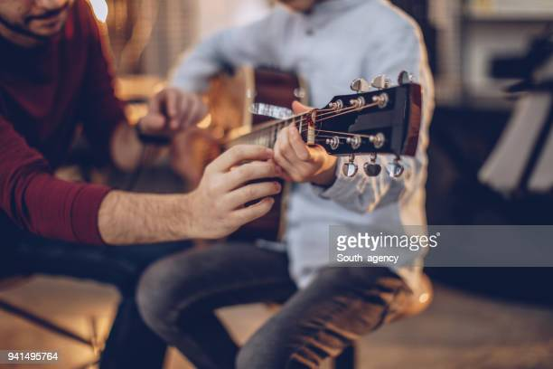 first guitar class - learning stock pictures, royalty-free photos & images