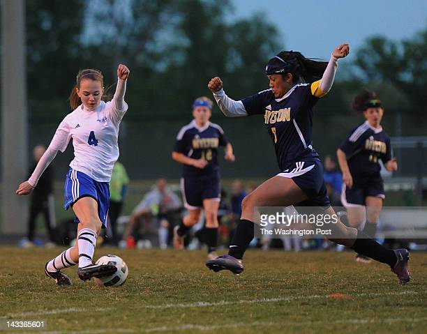 First half action as Forest Park's Jessica Leonard cuts hard left when she sees Hylton's Gaby Gonzales charging in to steal the ball on April 24,...
