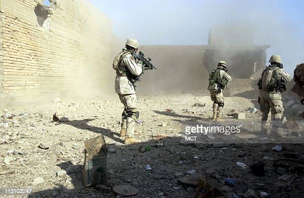 First Infantry Division soldiers battle insurgents in the northern district of Fallujah Iraq on Saturday November 13 2004