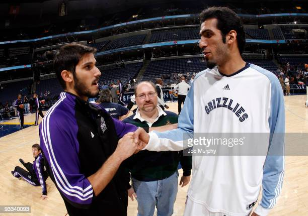 First Iranian NBA player Hamed Haddadi of the Memphis Grizzlies shakes hands pregame with first Israeli NBA player Omri Casspi the Sacramento Kings...