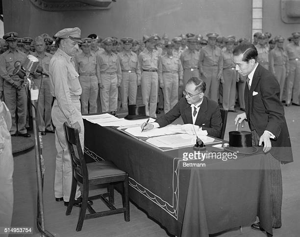 First Jap DelegateForeign Office Representative Signs Jap delegate Mamoro Shigemitsu and General Sutherland on left