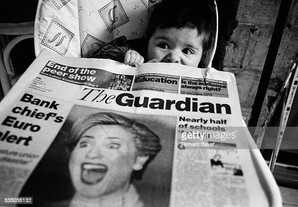 First ladies. A six month-old infant girl has a shocked look on her face as she plays with a copy of the broadsheet Guardian newspaper whose front...