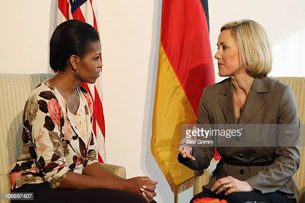 First Ladies Michelle Obama and Bettina Wulff chat during Obama's visit at the Ramstein Air Force Base on November 11 2010 in RamsteinMiesenbach...