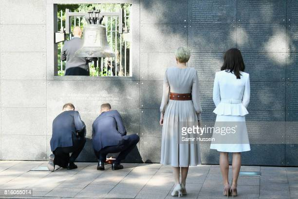 First Lady Agata KornhauserDuda and Catherine Duchess of Cambridge look on as President Andrzej Duda and Prince William Duke of Cambridge light a...