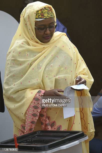 First lady Aisha Buhari wife of candidate of the All Progressives Congress and incumbent President casts her vote at a polling station in Daura in...