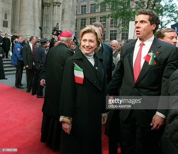 First Lady and Democratic candidate for Senate Hillary Clinton stands with US Housing Secretary Andrew Cuomo in front of St Patrick's Cathedral...