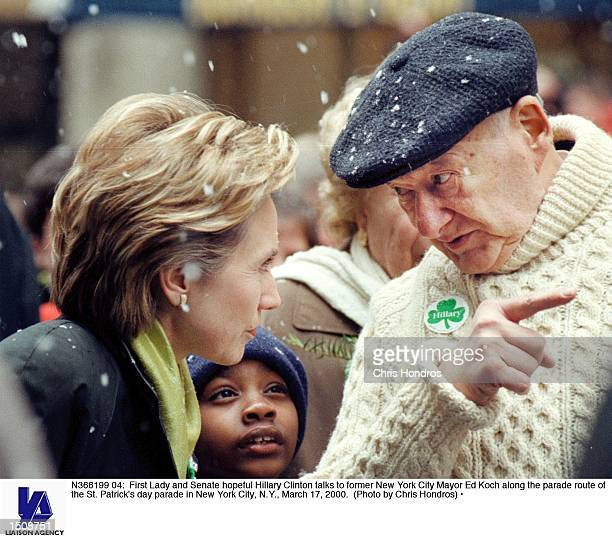 First Lady and Senate hopeful Hillary Clinton talks to former New York City Mayor Ed Koch along the parade route of the St Patrick's day parade in...