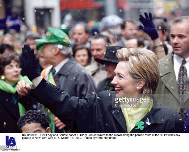 First Lady and Senate hopeful Hillary Clinton waves to the crowd along the parade route of the St Patrick's day parade in New York City NY March 17...