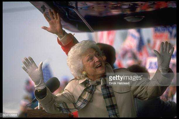 First Lady Barbara Bush enthusiastically greeting supporters on stop accompanying her husband Pres on his reelection campaign whistlestop train tour