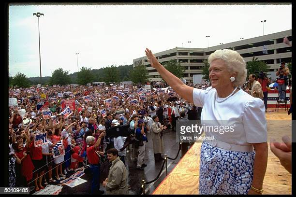 First Lady Barbara Bush waving to crowd at campaign rally