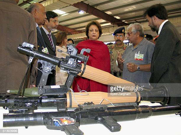 First Lady Begum Sehba Musharraf visits a stall during during a tour of the International Defence Exhibition Seminar September 14 2004 in Karachi...