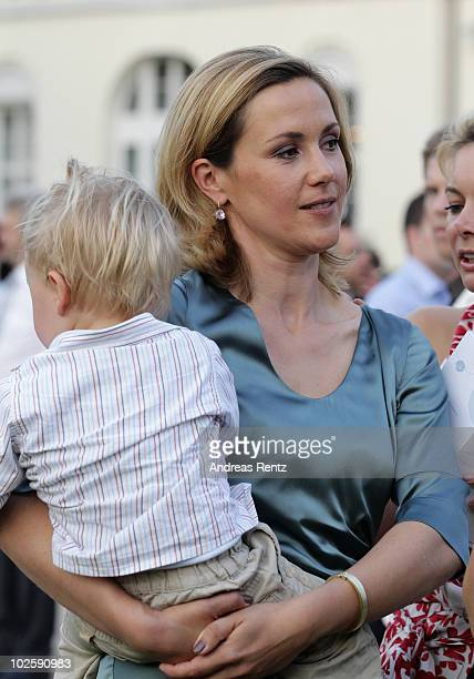 First Lady Bettina Wulff and her son Linus attend at the President's annual summer garden party at Schloss Bellevue presidential palace on July 2,...