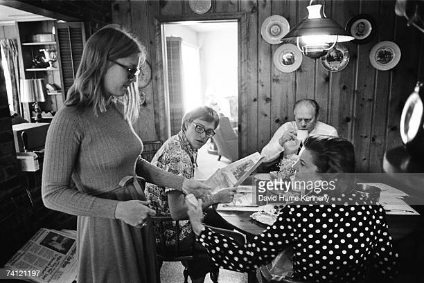 First Lady Betty Ford chats with daughter Susan Ford while son John Jack Ford and President Gerald R Ford finish breakfast in the family home on...