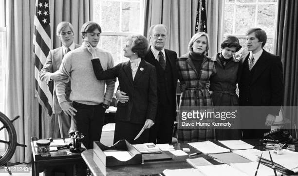 First Lady Betty Ford comforts her son John Ford as the family gathers in the Oval Office following the President's concession of the 1976...