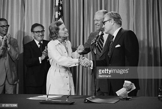 First Lady Betty Ford greets Nelson Rockefeller as he arrives in the Oval Office of the White House 8/20 to hear Pres. Ford tells a nationwide TV...