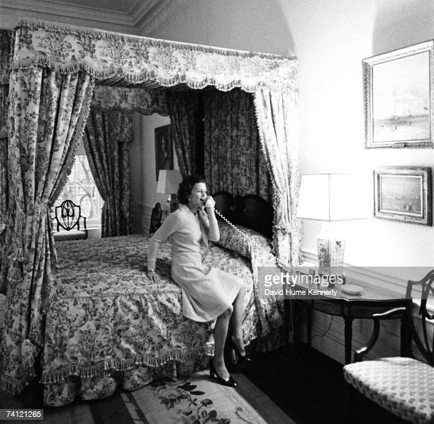 First Lady Betty Ford takes a phone call in the second floor Queen's bedroom while touring the White House Executive Residence where presidents and...