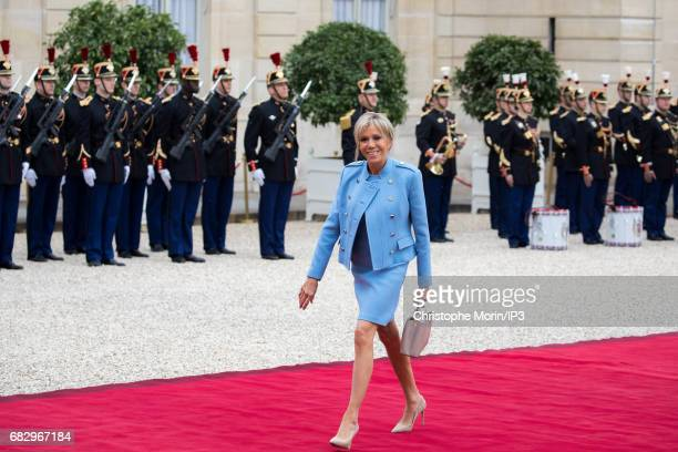 First Lady Brigitte Trogneux arrives ten minutes before her husband the new French President elected Emmanuel Macron to attend a formal ceremony as...