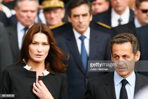 First Lady Carla BruniSarkozy French President Nicolas Sarkozy and French Prime Minister Francois Fillon leave the Notre Dame Cathedral after...