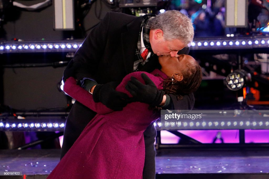 First Lady Chirlane McCray and New York City Mayor Bill de Blasio share a midnight kiss at Dick Clark's New Year's Rockin' Eve at Times Square on December 31, 2017 in New York City.