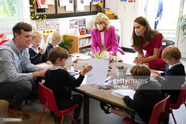 First Lady Dr Jill Biden and Catherine, Duchess of Cambridge talk with children in the schools Reception Class during a visit to Connor Downs...