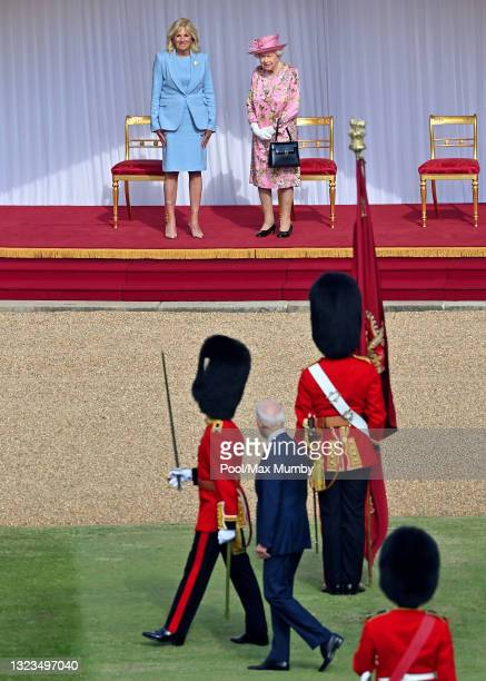First Lady Dr Jill Biden and Queen Elizabeth II look on as U.S. President Joe Biden inspects a Guard of Honour during his ceremonial welcome at...