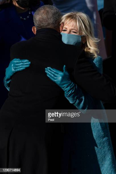 First lady Dr. Jill Biden hugs former President Barack Obama as she departs from the inaugural stage at the end of the ceremony on the West Front of...