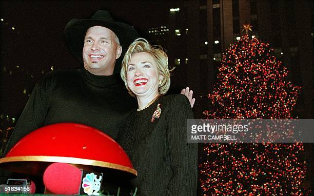 First Lady Hillary Clinton and country music star Garth Brooks pose for photographers with the big red button shortly after they lit the Christmas...