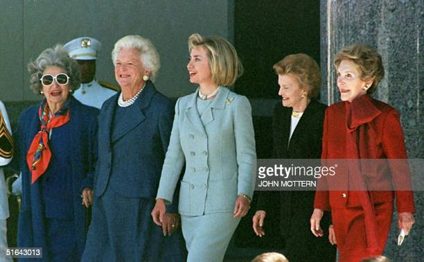 First Lady Hillary Clinton and former First Ladies Lady Bird Johnson, Barbara Bush, Betty Ford, and Nancy Reagan walk together to the platform during...