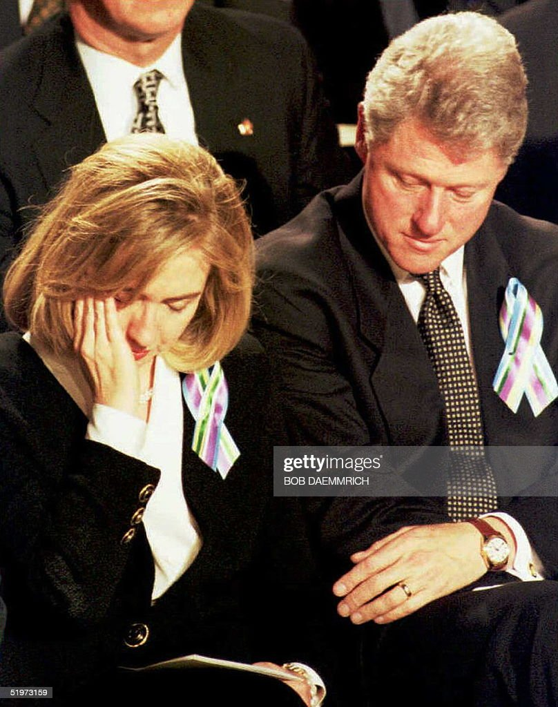 US First Lady Hillary Clinton(L) and US President Bill Clinton(R) listen to a speech during a prayer service for the families of victims of the 19 April bomb attack on the Federal Building in Oklahoma City. The service was held at the Oklahoma City State Fair Arena in Oklahoma City.