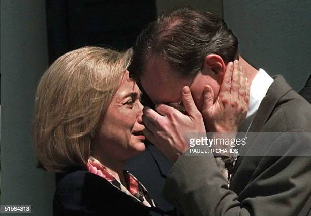 First Lady Hillary Clinton comforts her press aide Neel Lattimore after prayer services for US Secretary of Commerce Ron Brown 04 April at St John's...