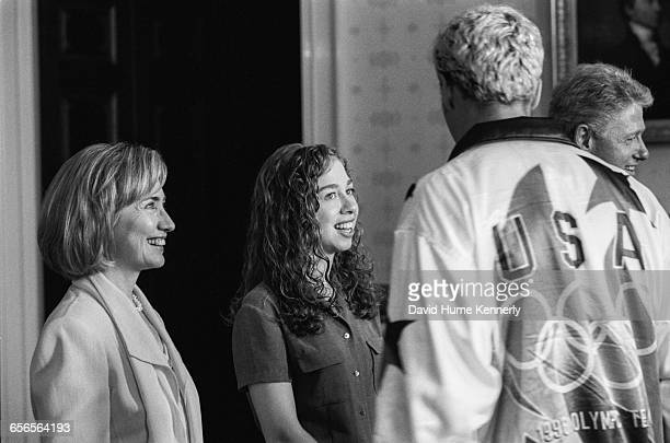 First Lady Hillary Clinton daughter Chelsea and President Bill Clinton greet a member of the US Olympic Team during a reception at the White House on...