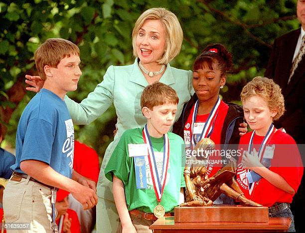 First Lady Hillary Clinton is presented with the Children's Champion of the Year Award 28 May in ceremonies at the White House in Washington, DC, by...