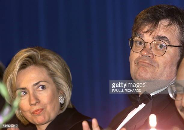 First Lady Hillary Clinton looks towards featured entertainer Garrison Keillor at the Radio TV Correspondents Annual Dinner 18 March 1999 at the...
