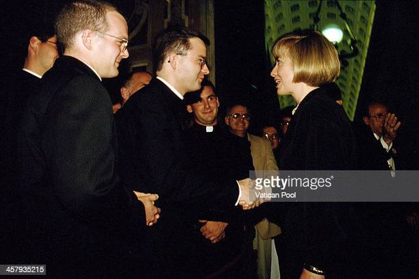 First Lady Hillary Clinton shake hands with young priests at the Paul VI Hall after a meeting with Pope John Paul II during the official visit of...