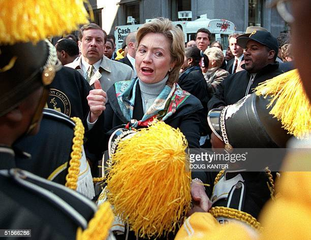 First Lady Hillary Clinton shakes hands with members of a marching band before the start of the Columbus Day Parade in New York 09 October 2000...