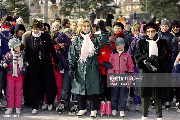 First Lady Hillary Clinton skates on the Rideau Canal on February 24, 1995 with Canadian Prime Minister wife Aline Chretien while waving at a local...