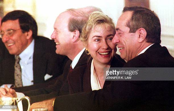 S First Lady Hillary Clinton smiles at New York Gov Mario Cuomo 01 February 1993 during a meeting with US governors to discuss health care...