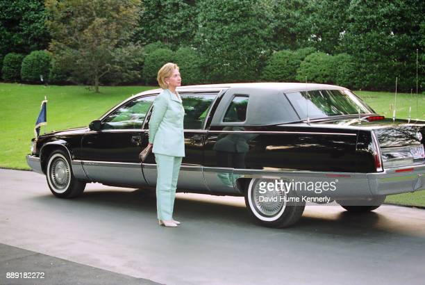 First Lady Hillary Clinton waits for her husband outside the White House on their way to a Democratic Business Leaders event the day after Special...