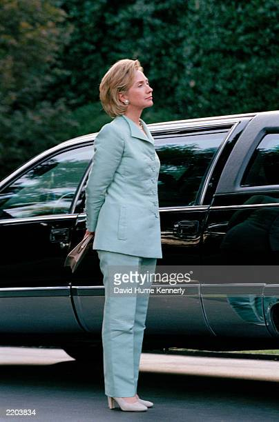 First Lady Hillary Clinton waits to depart with husband U.S President Bill Clinton after a Democratic Business Leaders event September 10, 1998 in...