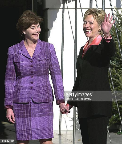 First Lady Hillary Clinton waves as she greets future First Lady Laura Bush 18 December 2000 at the White House in Washington DC Both Mrs Bush and...