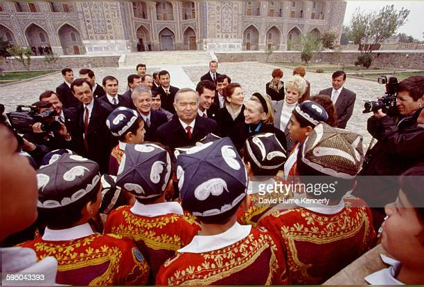 S First Lady Hillary Clinton with Uzbek President Islam Karimov and his wife Tatiana Karimova chat with a group of young traditional Uzbek musicians...