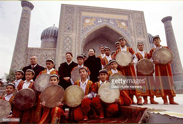 S First Lady Hillary Clinton with Uzbek President Islam Karimov and his wife Tatiana Karimova pose with a group of young traditional Uzbek musicians...