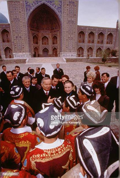 S First Lady Hillary Clinton with Uzbek President Islam Karimov chat with a group of young traditional Uzbek musicians November 14 1997 in Samarkand...