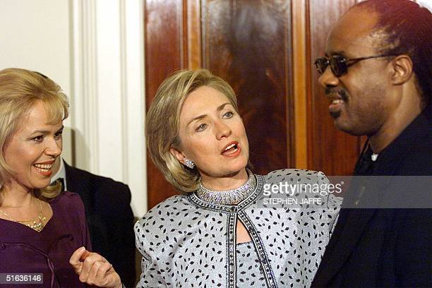 First Lady Hillary Rodham Clinton and Dagmar Havlova wife of Czech Republic President Vaclav Havel greet singer Stevie Wonder in a receiving line...